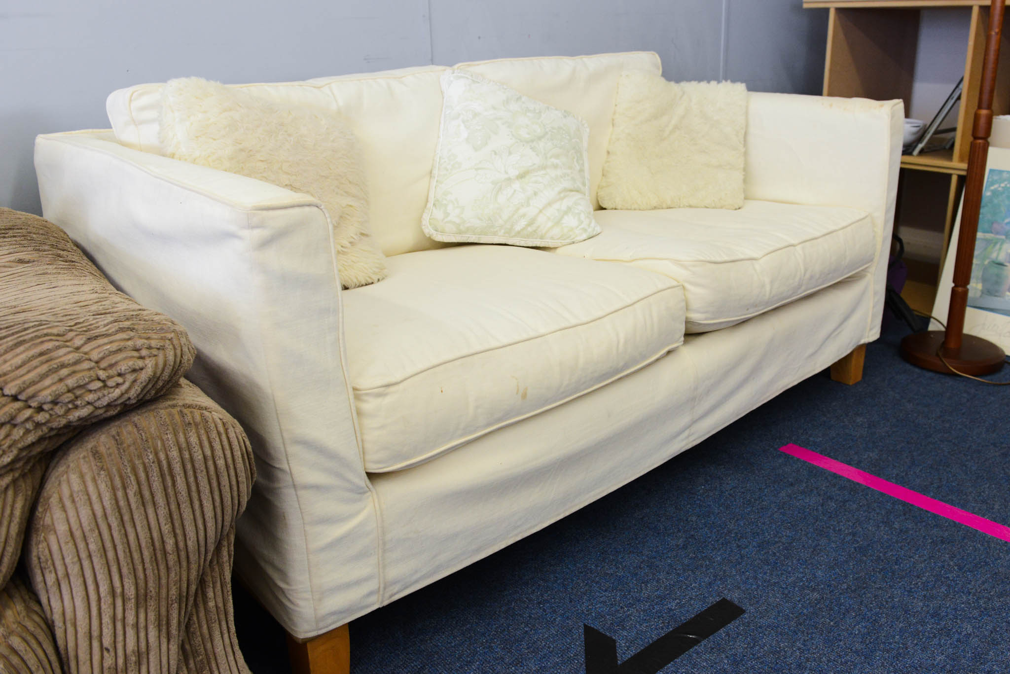 Large two seater sofa with removable covers in off white. Easy to launder or dye to change colour