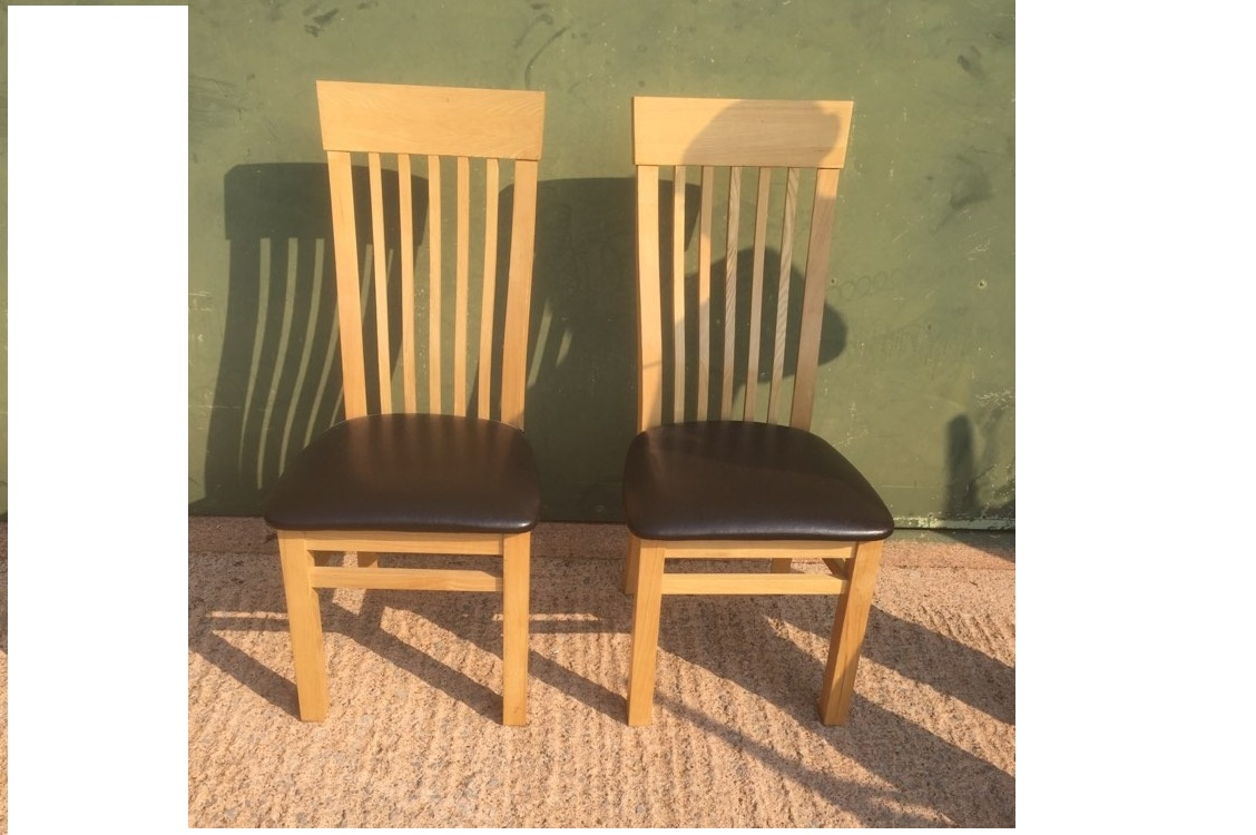 Pair of light Oak dining chairs with leather seats in very good condition. 108cm tall, 49cm to seat base.