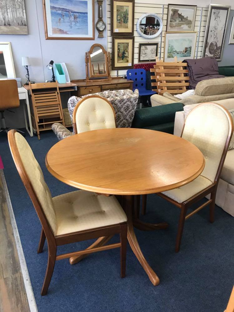 Extendable circular dining table and 4 upholstered chairs, purchased new from Sutcliffe furniture in 2004 for £1609 (!). Table extends with a butterfly mechanism in the middle.