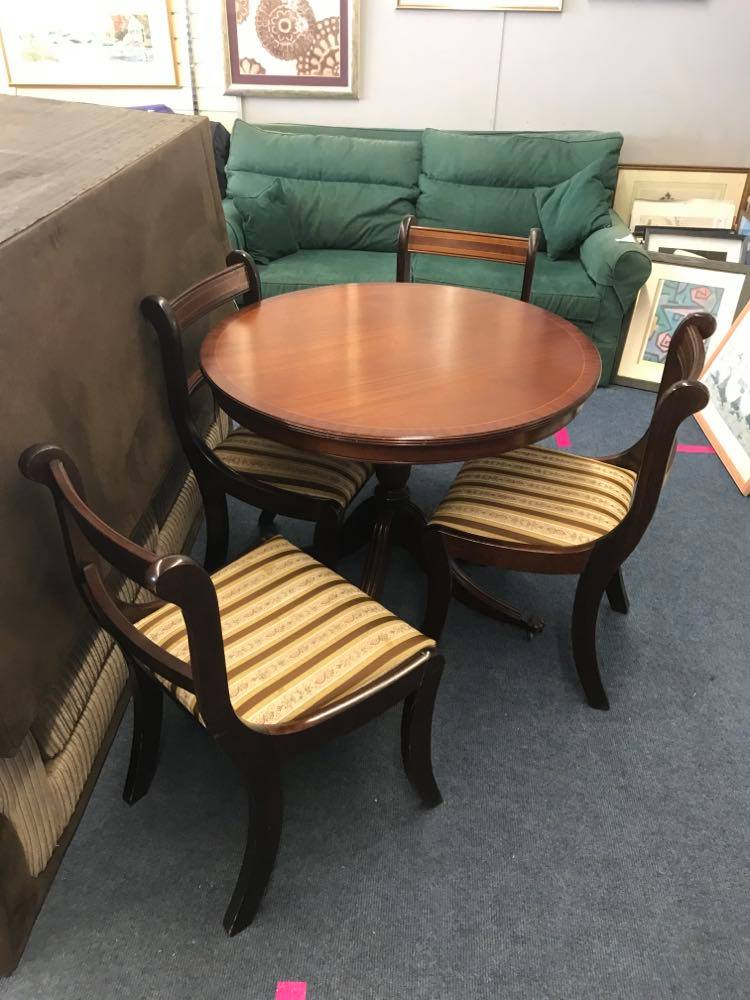 Circular tilt top dining table and 4 chairs in very good condition