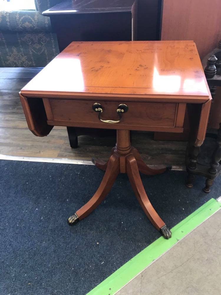 Drop leaf side table with a drawer.