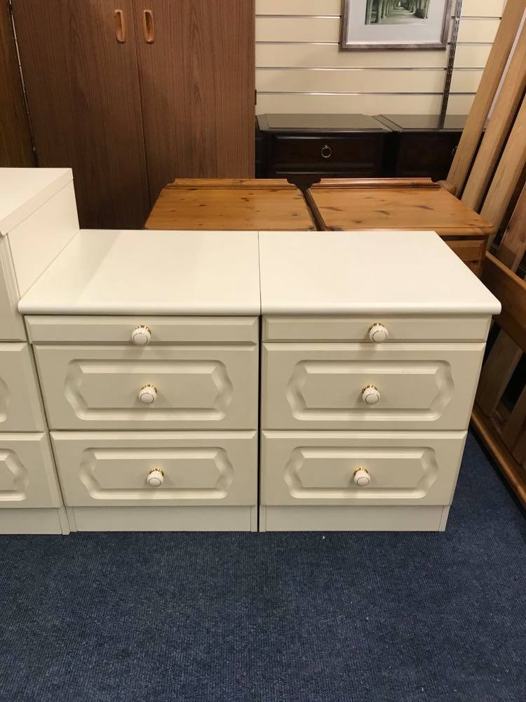 Pair of large white bedside cabinets in very good condition. Matching chest of drawers also available.