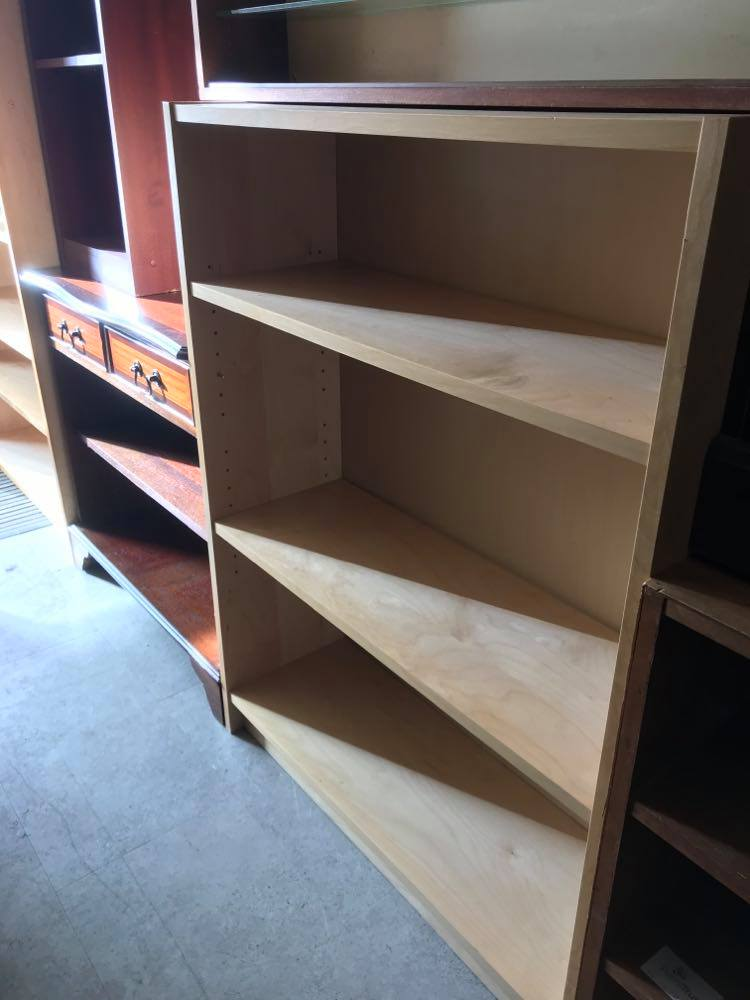 Low Ikea bookshelf in light wood finish