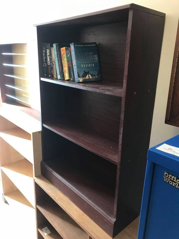 Small bookcase in dark wood finish