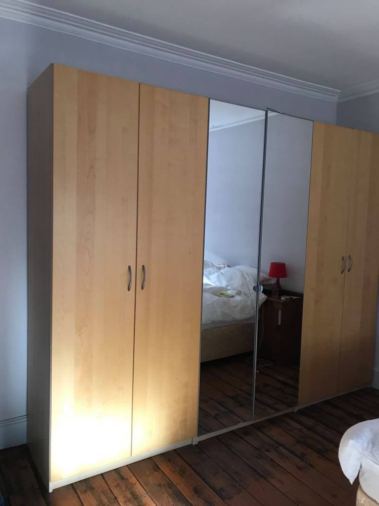Ikea PAX Wardrobes. Very large! 240cm tall, 100cm wide, 60 cm deep.   5 available complete with drawers, shelves and hanging rails, 1 with full height mirrored doors. Dismantled for (relatively) easy transport. £100 each.