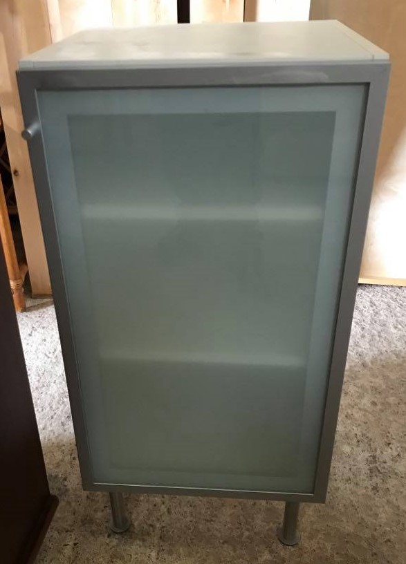 Ikea Vättern bathroom cabinet with reversible door & 2 shelves, on 4 chrome adjustable legs. We have 4 of these available.